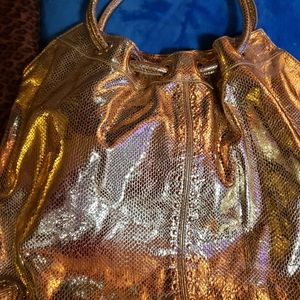 AUTHENTIC LG GOLD MICHAEL KORS $99